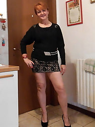 Sexy granny redhead with hot shapely legs