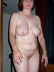 Lovely older girl is posing naked at home